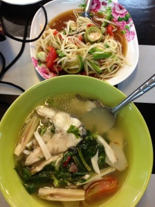 Spicy fish soup and papaya salad.